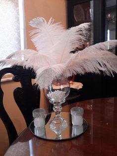 Great Gatsby inspired Ostrich Glitter tips Centerpiece Set includes: 1 ea 10 round mirror 2 ea Glass votive holder with bling / candle - approx. burn time 8-10 hrs 12 ea 10- 14 Ostrich Feathers white with glitter tips - 6 with glitter - 6 without 1 ea Pedestal vase with Bling Ribbon 1 ea Pearl Great Gatsby Themed Party, Great Gatsby Wedding, Gold Wedding, 1920s Wedding, Wedding Flowers, Eiffel Tower Centerpiece, Ostrich Feather Centerpieces, Roaring 20s Party, Sweet 16