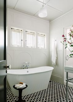 This is a scene from the library house. How appropriately titled, as can't you just envision yourself, soaking in that tub with a good book and some cool tunes playing? Soaking tubs are always a welcome addtion to any bathroom. Love the tile floor as well.