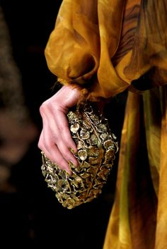 clutch/nails/cuffed sleeve detail, Alexander McQueen Spring 2011 rtw
