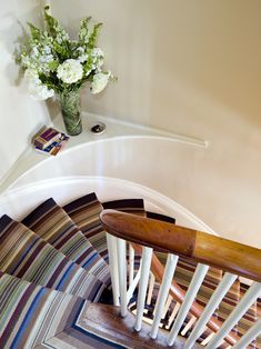 another decorating challenge in my house -- the curved shelf halfway up the stair.
