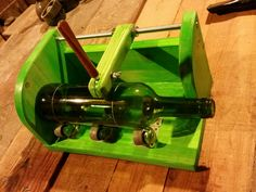 This is how I cutt bottles. I built this jig to make a clean and straight scar perpendicular to the bottle's vertical axis. The threaded rod and nuts allow the glass cutter to be adjusted to cut different bottle lengths. After marking the scar, I pour boiling water on it and then I plunge the bottle into icy water. Sudden temperature change makes the bottle to split in two leaving a perfect cut. Then I smooth the glass edges with fine grit sand paper.