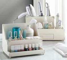 Neat bath storage for keeping girl tools at the ready without cluttering a man's bath.