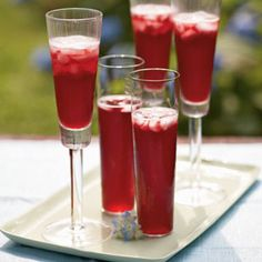 Champagne Pomegranate Cocktail -- Pomegranates add festive color and great flavor to any cocktail. Create a sparkling celebration by combinating tart pomegranate juice with spicy ginger ale, a little brandy, and a bottle of bubbly Champagne.
