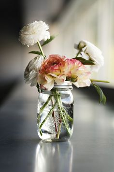 we love to put flowers in mason jars! ~ another beautiful way to reuse them after the candle has melted ~