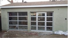 Glass garage doors for my studio. Would be a lot nicer than closing off one door with a wall with a window in it. Would make the space seem open and bright.