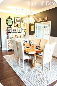 "great gallery wall...loving the chandelier and the ""laugh"" sign on the chocolate wall!"