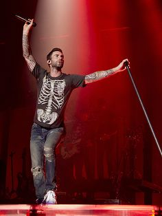 Star Tracks: Tuesday, June 16, 2015 | HANDS IN THE AIR | Adam Levine is lost in the music as he performs with Maroon 5 at the Barclaycard Center in Madrid, Spain, on Monday night.