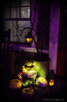 Love the lantern on the branch and that green glow around the pumpkins...very nice