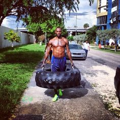 It's just LeBron James walking down the street with a giant tire