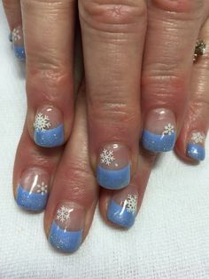Light blue with glitter and snowflakes French gel nails. All done with non-toxic and odorless gel.