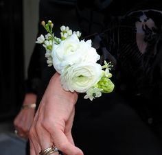 White Ranunculus Corsage - imagine in pink - this is VERY traditional.