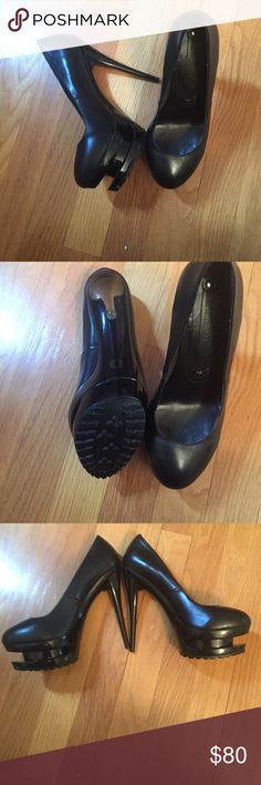 Size 37 black platform pumps NWOT no box. Black leather platform pumps never worn. Styled after Gianmarco Lorenzi. Super cute and sexy. Size 37 Shoes Heels