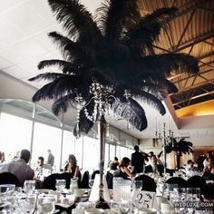 Black ostrich feather centerpieces. Swanky!