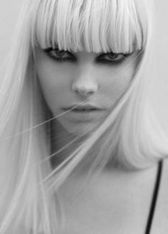 long hair blunt bangs bleached blonde platinum hair