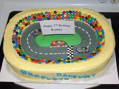 This was for my son's 7th birthday.  I used a 2 layer 1/2 sheet cake and carved the stadium out of it.  Buttercream for the icing, m&m's for the crowd, chocolate race cars.  Everyone loved it!!!