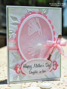 For this card, a Leafy embossing folder halos a stamped floral image on a die cut shape. The de-bossed leaf side was inked with Bundled Sage Distress Ink.
