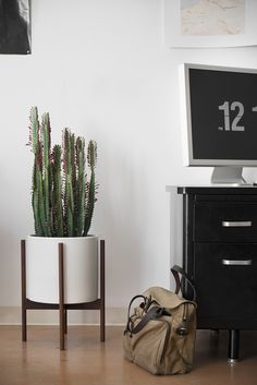A mid-century inspired high-fire ceramic stoneware planter, designed to be used indoors or out. #TRNK
