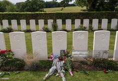 Flowers and photos at the grave of Private Robert Boulanger of Les Fusiliers Mont-Royal, R.C.I.C, at Canadian War Cemetery near Dieppe, France, 19 August 2013, on the 73rd anniversary of the Dieppe raid. More than 6000 allied troops, mostly Canadians, landed on 19 August 1942. At the end of the day, after a fierce battle, the Allies had 1550 dead and some 2400 prisoners. 948 Commonwealth servicemen of WWII are buried or commemorated in this cemetery.