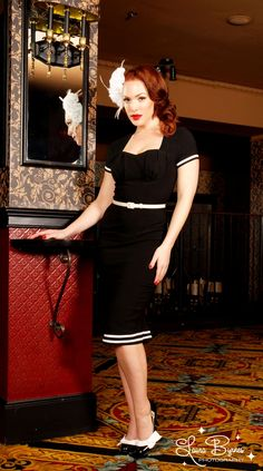 Military Pinup Dress in Black with White Trim - The new Military Pinup dress saunters confidently right out of a 1940s office with a military twist and modern comfort.  Made of a favorite wiggle fabric, our curve-loving Bengaline, this dress is features a constructed bust that is ideal for smaller busts, a saucy kick pleat and back zip, and is finished off with a contrast belt and back zip.