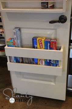 Store tinfoil, zip-locks, etc on pantry door.  Instructions for building pantry door organizer.  I can't wait until we have our own house!