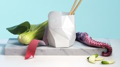 Two designers and a team of scientists have reinvented the takeout container for our sustainable century.