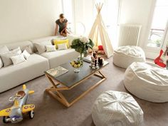 The simple addition of a teepee makes this living room more kid-friendly.