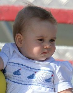 Looking rather cute in his sail boat picture smocked romper is the young Prince George