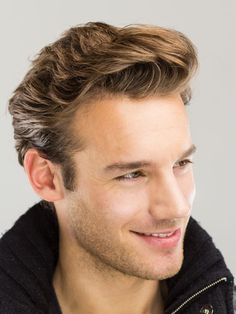 Wavy Brush Up Hairstyle - Thick hair becomes soft and smooth with this wavy style. The hair in front is brushed up into a makeshift side swept quiff and the rest of the hair is kept full for maximum effect.