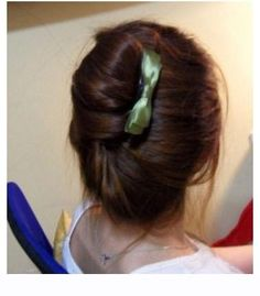"""Lazy French Twist Updo     backcomb all around outside & top of hair & comb to smooth out some for volume + loose ponytail off center to account fo twist + sideways Topsy-tail + shove all the rest of hair in """"hole"""" & smooth & bobby pin as needed but be messy throughout == love the softness & poofyness plus whispys   PICT ONLY"""