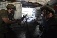 Members of the Right Sector\u0027s Ukrainian Volunteer Corps guard their position at the Butovka coal mine near Donetsk, Ukraine, June 7, 2015. REUTERS/Oleksandr Klymenko