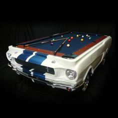 PLEASE NOTE: Professional delivery and installation required; please contact our Product Specialist department to order at (800) 537-8484.    Carroll Shelby and Mustang. Few names are more synonymous with high-performance racing and classic American car culture. This remarkable billiards table    pays tribute to the classic 1965 Shelby GT 350 Mustang and was autographed by the late automotive icon himself. Directly molded from the body of an    original GT 350 and finished in a…