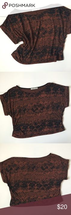 "Chloe K Patterned Crop Top Chloe K patterned crop top!! Black and brown / burnt orange. Sleeves have a small cuff. 17 1/2"" long, 20"" wide, about 10 1/2"" open neckline. 50% polyester and 50% rayon. Very soft!! Semi sheer so you might want to layer. Great condition. NO TRADES. Chloe K Tops"