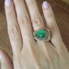 This ring is made of sterling silver and a stunning emerald colored crystal, that we found in an antique shop. Handmade by us of course!