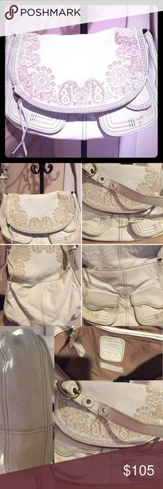 """LUCKY BRAND """"STASH"""" ivory w/ taupe embroidery. 🚨SALE🚨****BUY BROWN & WHITE for $198!**24 HOURS ONLY!! 2 FOR 1!!! STEAL!!! Very Lightly loved, Ivory/off-white Lucky Brand """"Stash"""" original handbag. Multi-lengths allow for multi-use. Has 5 separate areas to """"stash stuff!! The large zippered compartment, (my fave), interior pockets, zipper, 3 magnetic closures. Soft LambSkin, treated leather to prevent stains. Each bag is $200 PLUS...and IF you find one in a discount store, like…"""