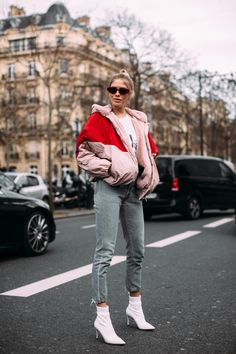 bomber jacket in pink color with pop of red, pop of red outfit, skinny jeans and white ankle boots look, light pink bomber jacket with red accents, millennial pink bomber jacket, powder pink bomber jacket with a red insert,
