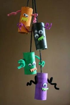 Cute craft to do with kids. Use toilet paper roll or cut a paper towel roll and paint and add your own design... you can stand them up or make a whole and hang from a string.  Fun Halloween or add cute colors and leafs for fall decor.