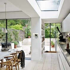 I have seen this gorgeous kitchen before - I think it's Dermot O'Leary. Love the pendant lights, wooden floorboards and black skylight.