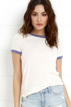 We're trying to snag the Obey Sold Out Blue-Violet and Cream Tee before it flies off the shelves! Blue-violet ribbed knit frames a crew neckline and short sleeves along the lightweight, slub knit bodice. Straight-cut tee silhouette is perfect to pair with your favorite distressed denim! Logo tag at hem.