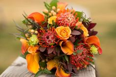I love fall colors! www.floraldesign.me #fallflowers #orangeweddings www.crystalmadsenphotography.com