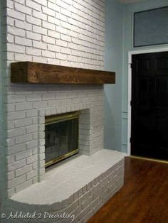 love the floating mantel; we should paint the brick! That could be great!
