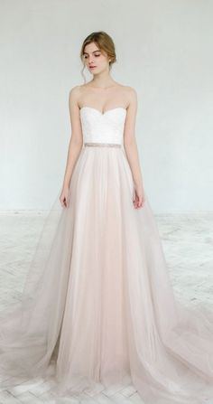 Breathtaking strapless white and blush wedding dress; Featured Dress: CarouselFashion
