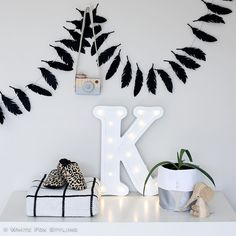 Look at these gorgeous nursery goodies! I'm in love with the stunning letter light by @minimarquee and that beautiful wooden camera from @behindthetrees_ Tap for details on the other fab products  #whitefoxstyling