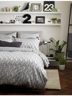 Monochrome bedroom interiors can be created in an instant with our Ferns Graphite Grey bedding set. We've paired ours with shelves, black and white accessories and a bundle of house plants!