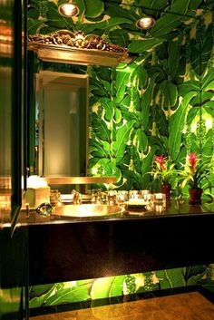 High drama is perfect in a powder room. Note under cabinet lighting. Brazillianc… High drama is perfect in a powder room. Note under cabinet lighting. Brazilliance – The Glam Pad Powder Room Wallpaper, Of Wallpaper, Botanical Wallpaper, Bathroom Wallpaper Leaves, Wallpaper Cabinets, Green Leaf Wallpaper, Interior Wallpaper, Tropical Wallpaper, Trendy Wallpaper