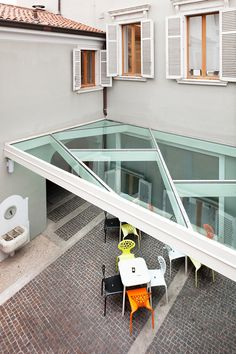 This is a small glass roof covering the outdoor space of a bar into a courtyrad.