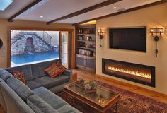Linear Fireplace Family Room Mediterranean with Bi Fold Doors Built in Cabinets Decorative Tile