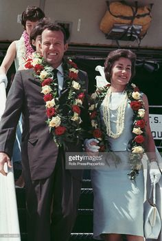 American Air Force test pilot and astronaut, Gordon Cooper (1927-2004) pictured with his wife Trudy arriving in Florida after leaving Hawaii following his Mercury-Atlas 9 space mission in May 1963.