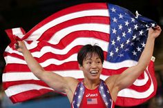 Clarissa Mei Ling Chun of US celebrates after defeating Ukraine's Irini Merleni for the bronze medal of the Women's 48Kg Greco-Roman wrestling