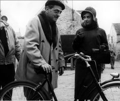 """Luis Bunuel and Jeanne Moreau on the set of """"Diary of a chambermaid"""" 1964."""