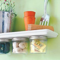 Attach lids to the underside of a shelf using adhesive or small screws then fill the jars and close them securely. Great idea for hanging herbs and seasonings in kitchen!
